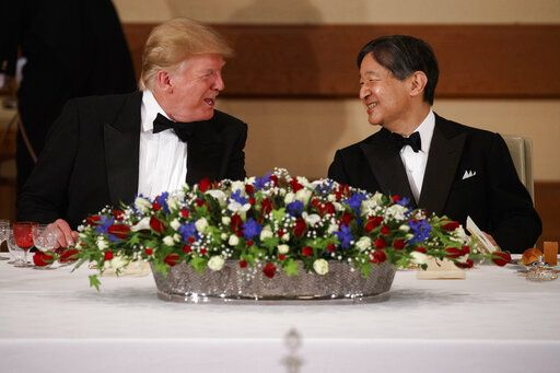 President Donald Trump talks with Japanese Emperor Naruhito during a State Banquet at the Imperial Palace, Monday, May 27, 2019, in Tokyo.
