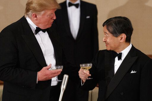 U.S. President Donald Trump toasts with Japan's Emperor Naruhito during a State Banquet at the Imperial Palace, Monday, May 27, 2019, in Tokyo.