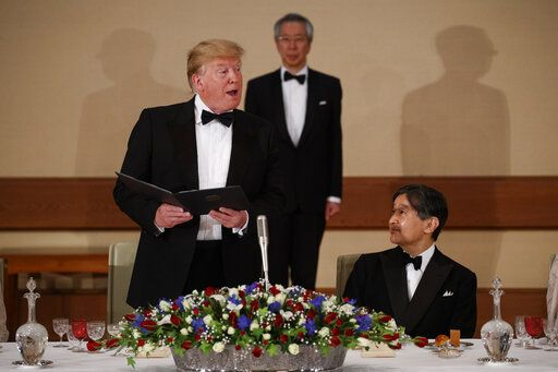 Japan's Emperor Naruhito, right, looks on as President Donald Trump speaks during a State Banquet at the Imperial Palace, Monday, May 27, 2019, in Tokyo.