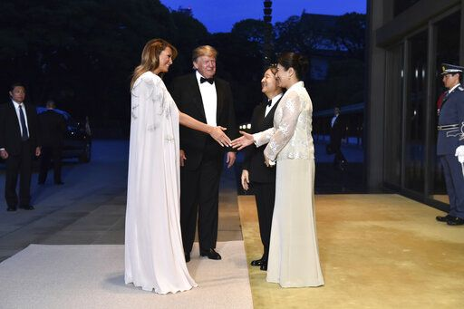 U.S. President Donald Trump, center left, and First lady Melania Trump, front left, are greeted by Japan's Emperor Naruhito, center right, and Empress Masako, front right, upon their arrival at the Imperial Palace for a state banquet in Tokyo Monday, May 27, 2019. (Kazuhiro Nogi/Pool Photo via AP)
