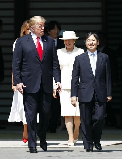 U.S. President Donald Trump, left, and first lady Melania Trump, rear left, are escorted by Japan's Emperor Naruhito and Empress Masako during an welcome ceremony at the Imperial Palace in Tokyo Monday, May 27, 2019. (Issei Kato/Pool Photo via AP)