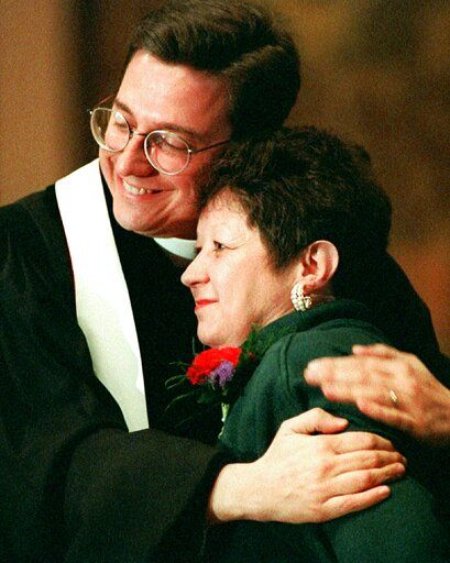 FILE - In this Sunday, Jan. 21, 1996 file photo, Norma McCorvey, Jane Roe in the 1973 Roe v. Wade decision, is embraced by The Rev. Robert L. Schenck of the National Clergy Council before she addresses a memorial service at Georgetown University in Washington. McCorvey, in town to join abortion opponents for their annual protest march, shocked abortion rights advocates in 1995 by announcing that she opposes the procedure.