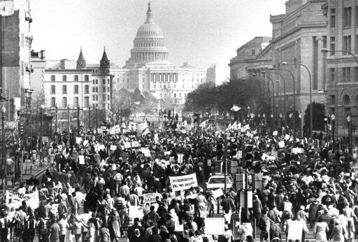 FILE - In this Jan. 22, 1981 file photo, several thousand marchers, protesting the 8-year-old Supreme Court decision permitting abortions, march down Pennsylvania Avenue in Washington toward the U.S. Capitol building. There have been major shifts in anti-abortion tactics. Compared to the 1990s, there are fewer mass demonstrations and clinic blockades, and far more success passing anti-abortion laws in Republican-controlled state legislatures. In the five years preceding this year's sweeping bans, scores of other laws have been passed to restrict abortion access.