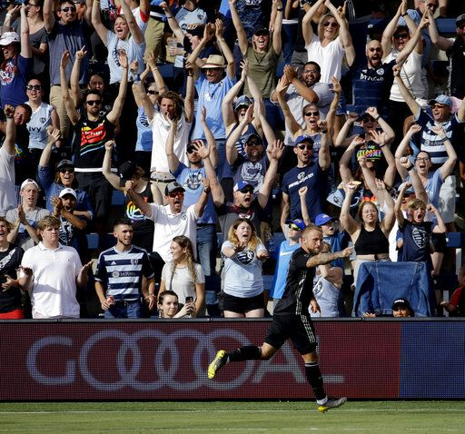 Sporting Kansas City forward Johnny Russell celebrates after scoring a goal during the first half of an MLS soccer match against the Seattle Sounders, Sunday, May 26, 2019, in Kansas City, Kan.