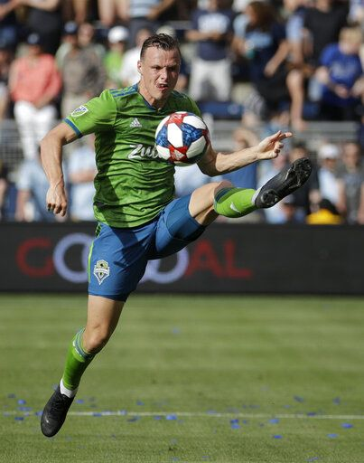 Seattle Sounders defender Brad Smith passes the ball during the first half of an MLS soccer match against Sporting Kansas City, Sunday, May 26, 2019, in Kansas City, Kan.