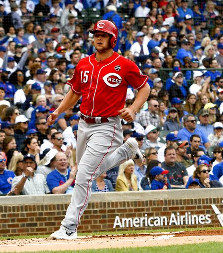 Cincinnati Reds' Nick Senzel (15) scores during the first inning of a baseball game against the Chicago Cubs Sunday, May 26, 2019, in Chicago.