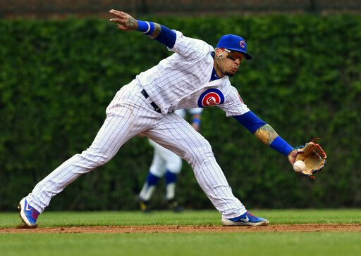 Chicago Cubs shortstop Javier Baez (9) catches a ball hit by Cincinnati Reds' Jose Peraza (9) during the second inning of a baseball game Sunday, May 26, 2019, in Chicago.