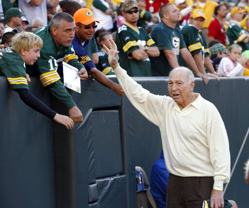 FILE - In this Sept. 10, 2012, file photo, former Green Bay Packers quarterback Bart Starr waves to fans during the Packers' NFL football game against the San Francisco 49ers in Green Bay, Wis. Bart Starr, the Green Bay Packers quarterback and catalyst of Vince Lombardi's powerhouse teams of the 1960s, has died. He was 85. The Packers announced Sunday, May 26, 2019, that Starr had died, citing his family. He had been in failing health since suffering a serious stroke in 2014.