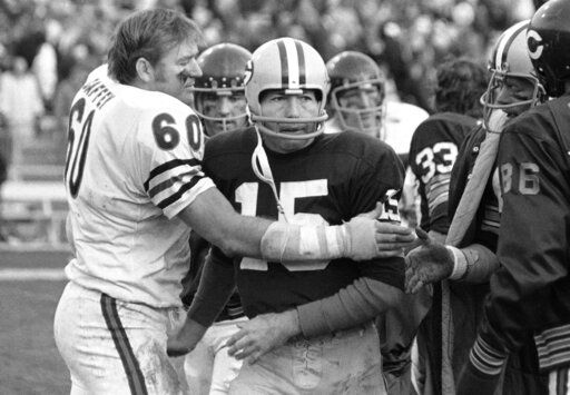 FILE - In this Nov. 16, 1970, file photo, Chicago Bears' Lee Roy Caffey (60) congratulates Green Bay Packers quarterback Bart Starr after Starr scored the winning touchdown at a football game in Green Bay, Wisc. Starr, the Green Bay Packers quarterback and catalyst of Vince Lombardi's powerhouse teams of the 1960s, has died. He was 85. The Packers announced Sunday, May 26, 2019, that Starr had died, citing his family. He had been in failing health since suffering a serious stroke in 2014.