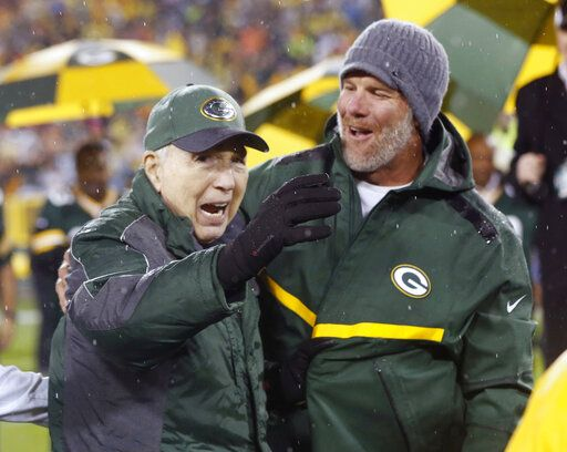 FILE - In this Thursday, Nov. 26, 2015, file photo, Brett Favre, right, smiles at Bart Starr during a ceremony at halftime of an NFL football game between the Green Bay Packers and Chicago Bears in Green Bay, Wis. Starr, the Green Bay Packers quarterback and catalyst of Vince Lombardi's powerhouse teams of the 1960s, has died. He was 85. The Packers announced Sunday, May 26, 2019, that Starr had died, citing his family. He had been in failing health since suffering a serious stroke in 2014.