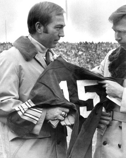 FILE - In this Nov. 12, 1973, file photo, former Green Bay Packers quarterback Bart Starr accepts jersey No. 15 as the number was retired during halftime ceremonies of the Green Bay vs St. Louis Cardinals football game in Green Bay, Wisc. Starr, the Green Bay Packers quarterback and catalyst of Vince Lombardi's powerhouse teams of the 1960s, has died. He was 85. The Packers announced Sunday, May 26, 2019, that Starr had died, citing his family. He had been in failing health since suffering a serious stroke in 2014.