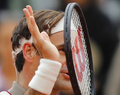 Switzerland's Roger Federer celebrates winning in three sets 6-2, 6-4, 6-4, against Italy's Lorenzo Sonego during their first round match of the French Open tennis tournament at the Roland Garros stadium in Paris, Sunday, May 26, 2019.