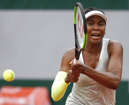 Venus Williams of the U.S. plays a shot against Ukraine's Elina Svitolina during their first round match of the French Open tennis tournament at the Roland Garros stadium in Paris, Sunday, May 26, 2019.