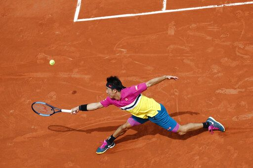 Japan's Kei Nishikori plays a shot against France's Quentin Halys during their first round match of the French Open tennis tournament at the Roland Garros stadium in Paris, Sunday, May 26, 2019.