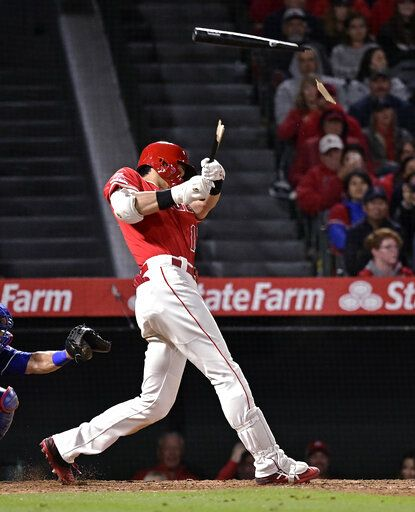 Los Angeles Angels' Shohei Ohtani, of Japan, breaks his bat as he lines out during the eighth inning of a baseball game against the Texas Rangers Saturday, May 25, 2019, in Anaheim, Calif.