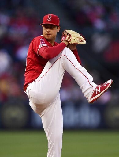 Los Angeles Angels starting pitcher Tyler Skaggs winds up during the first inning of the team's baseball game against the Texas Rangers on Saturday, May 25, 2019, in Anaheim, Calif.