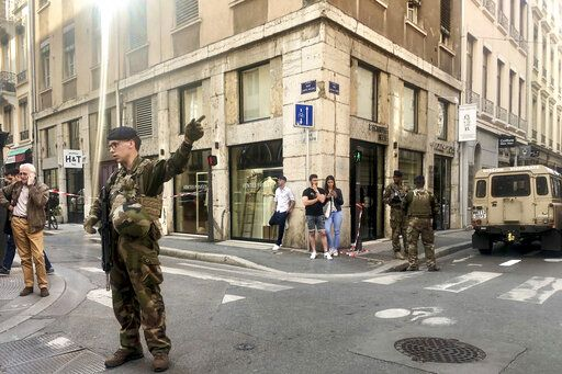 "Soldiers of French anti terrorist plan ""Vigipirate Mission"", secure the area, near the site of a suspected bomb attack in central Lyon, Friday May, 24, 2019. A small explosion Friday on a busy street in the French city of Lyon lightly injured several people, local officials said."