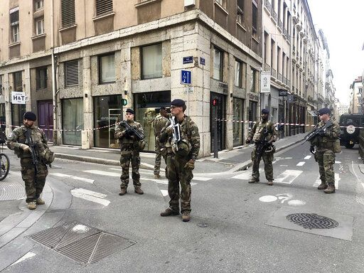 "Soldiers of French antiterrorist plan ""Vigipirate Mission"", secure the access near the site of a suspected bomb attack in central Lyon, Friday May, 24, 2019. A small explosion Friday on a busy street in the French city of Lyon lightly injured several people, local officials said."