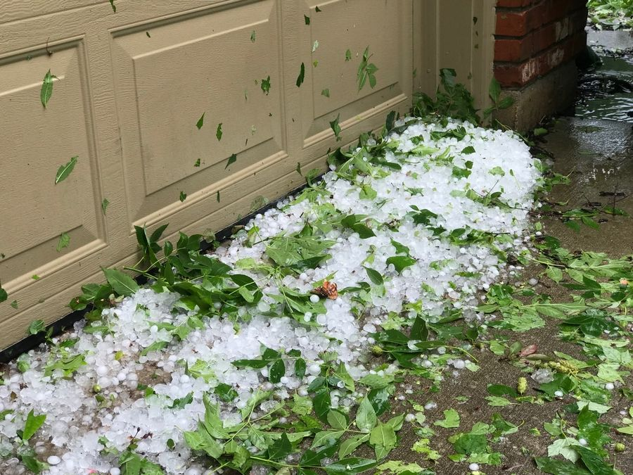 Hail piled up in Naperville after Monday's storms in Naperville and Aurora.