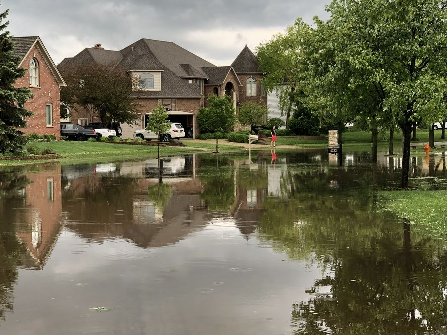 Memorial Day storms left streets flooded and caused hail damage in Naperville and other parts of the region. This already is the third-wettest May in our recorded history.