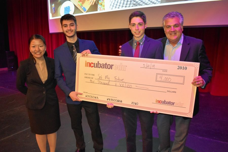 SetMyFuture, an INCubatoredu team from St. Charles North, won $4,000 for its job search website targeting teens and young adults. The startup team includes, from left, sophomore Brigid Redmond-Mattucci, senior Justin Powell, senior Dominick Mastrangeli and mentor George Caravelli. Student Lexxi Guadagnoli is not pictured.