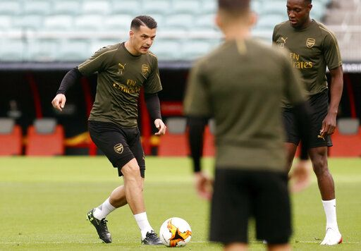 Arsenal's Granit Xhaka controls the ball during a soccer training session at the Olympic stadium in Baku, Azerbaijan, Tuesday May 28, 2019. English Premier League teams Arsenal and Chelsea are preparing for the Europa League Final soccer match that takes place in Baku on Wednesday night.