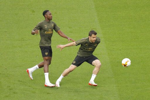 Arsenal's Danny Welbeck, left, and Arsenal's Sokratis Papastathopoulos take part in a soccer training session at the Olympic stadium in Baku, Azerbaijan, Tuesday, May 28, 2019. English Premier League teams Arsenal and Chelsea are preparing for the Europa League Final soccer match that takes place in Baku on Wednesday night.