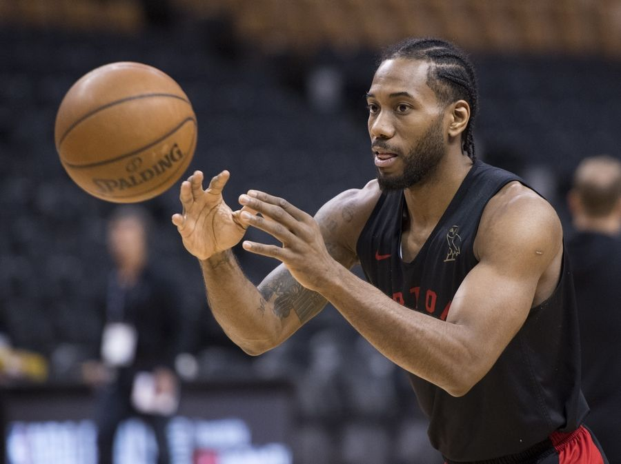 Toronto Raptors' Kawhi Leonard passes during practice for the NBA Finals in Toronto on Wednesday, May 29, 2019. Game 1 of the NBA Finals between the Raptors and Golden State Warriors is Thursday in Toronto. (Frank Gunn/The Canadian Press via AP)