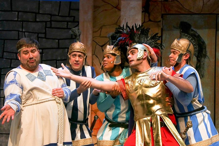 "Pseudolus (Tommy Bullington), left, shares bad news with Miles Gloriosus (Erik Dohner), second from right, and his soldiers (Nick Arceo, Natalie Renee Savoy and Eric Deutz) in the musical ""A Funny Thing Happened on the Way to the Forum"" at the Metropolis Performing Arts Centre."