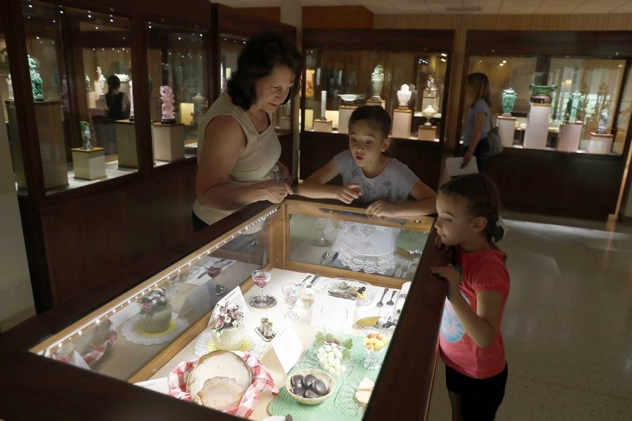 Addison resident Lena Prestia, left, looks over some of the exhibits at the Lizzadro Museum of Lapidary Art with her granddaughters Julia Knight, 9, and Emelyn Knight, 5. The museum closed Friday and will reopen in the fall in Oak Brook.
