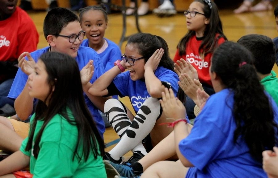 Marsha Tagala, a fifth-grader at West Oak Elementary School, reacts Thursday after the surprise announcement that she's the Illinois winner of the annual Google Doodle contest.