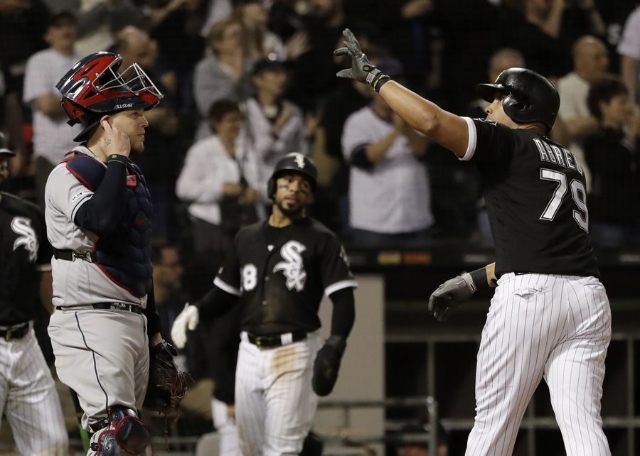 Chicago White Sox's Jose Abreu, right, celebrates after hitting a two-run home run as Cleveland Indians catcher Roberto Perez looks to the field during the seventh inning of a baseball game in Chicago, Thursday, May 30, 2019.