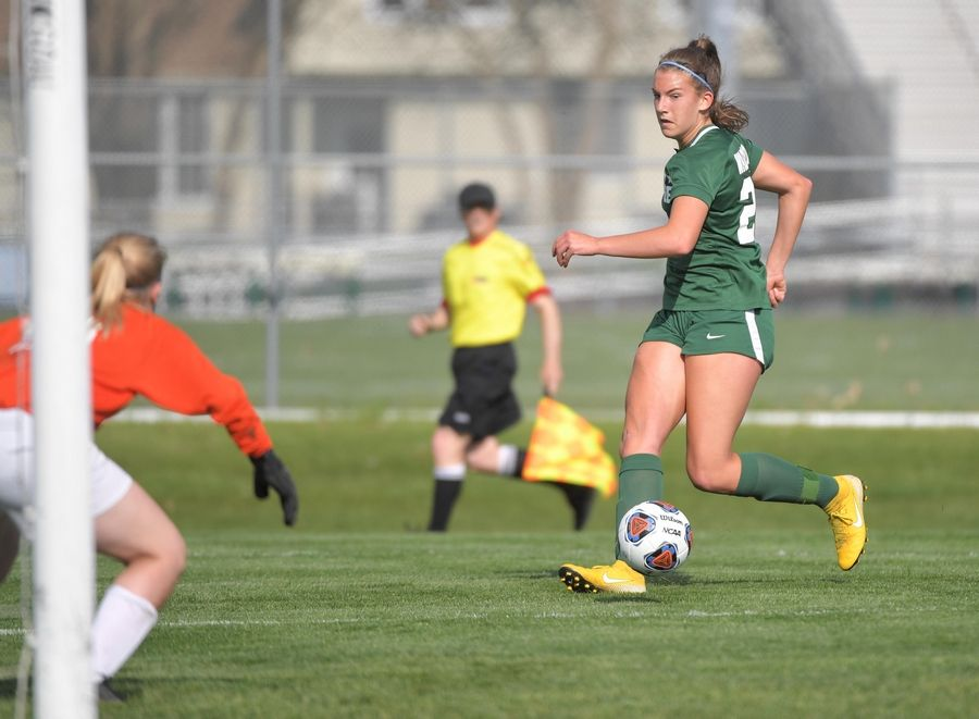 Waubonsie Valley's Grace Setter takes a shot against Oswego in the Class 3A Waubonsie Valley girls soccer regional semifinal game.
