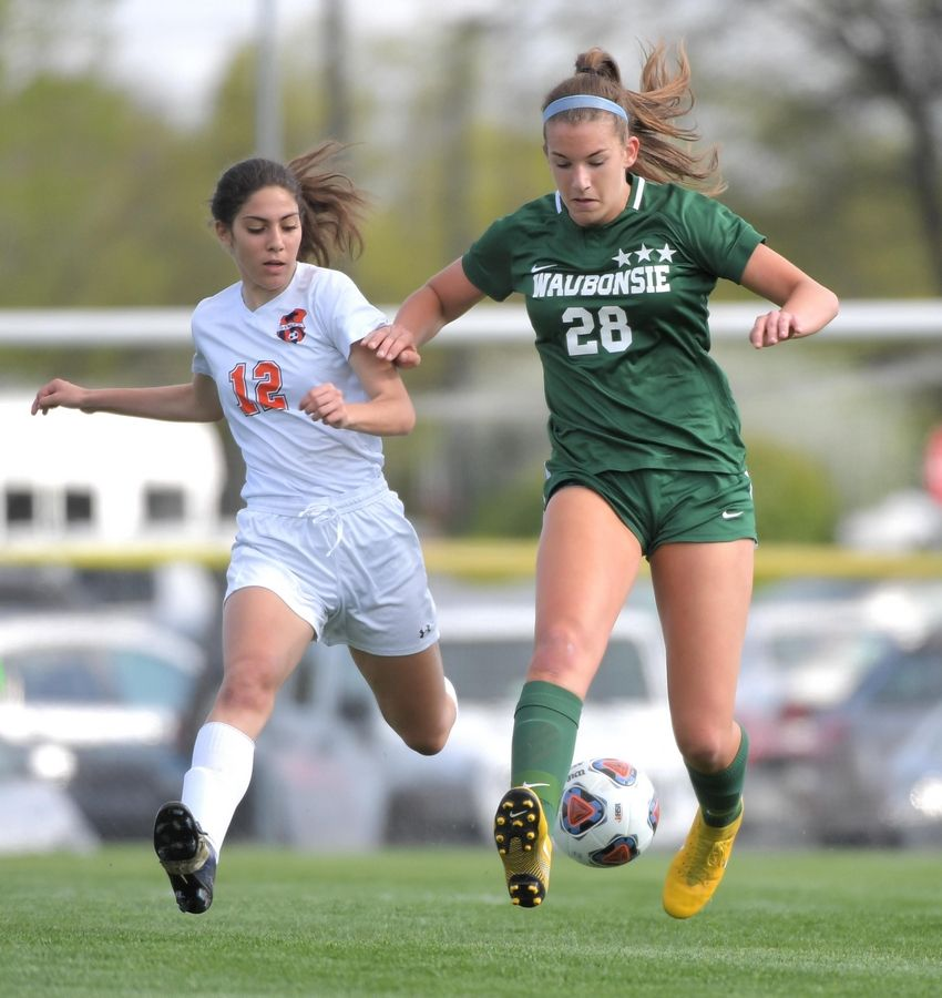 Waugonsie Valley's Grace Setter and Oswego's Arianna Panza battle for the ball in the Class 3A Waubonsie Valley girls soccer regional semifinal game.