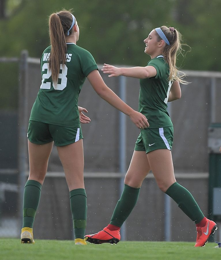 Waubonsie Valley's Megan Burling is congratulated by teammate Grace Setter after her first half goal against Oswego in the Class 3A Waubonsie Valley girls soccer regional semifinal game.