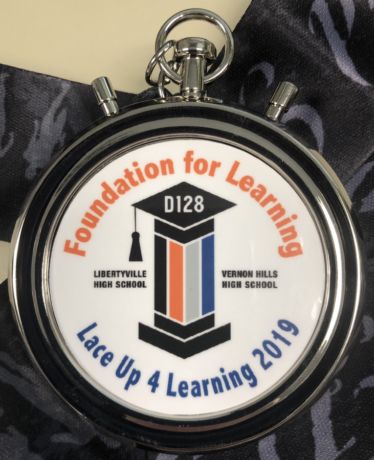 Race participants support the work done by the Foundation and receive an official race bib and medal (pictured).District 128 Foundation for Learning