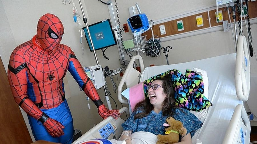 "A young patient enjoys a ""Holiday Heroes"" hospital party in honor of National Superhero Day on April 28. The ""Heroes of the Night Gala"" will be held Thursday, June 13, at the scenic Theatre on the Lake in Chicago."
