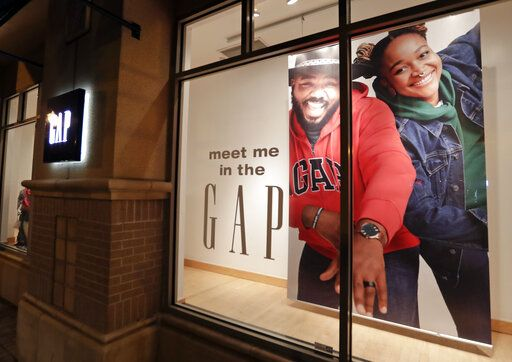 FILE - This Aug. 23, 2018, file photo shows a window display at a Gap clothing store in Winter Park, Fla. The Gap Inc. reports financial results Thursday, May 30, 2019.
