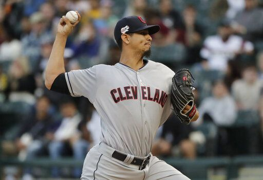 Cleveland Indians starting pitcher Carlos Carrasco throws to a Chicago White Sox batter during the first inning of a baseball game in Chicago, Thursday, May 30, 2019.