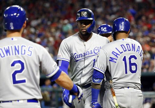 Kansas City Royals' Chris Owings (2) and Martin Maldonado (16) congratulate Jorge Soler, center, on his three-run home run against the Texas Rangers during the sixth inning of a baseball game in Arlington, Texas, Thursday, May 30, 2019.