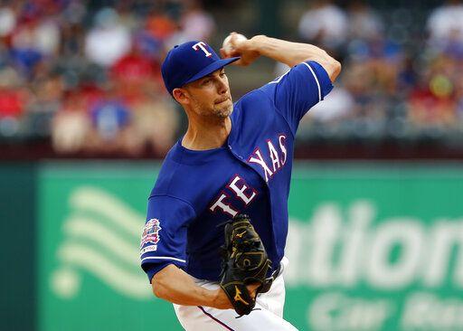 Texas Rangers starting pitcher Mike Minor throws to a Kansas City Royals batter during the first inning of a baseball game in Arlington, Texas, Thursday, May 30, 2019.