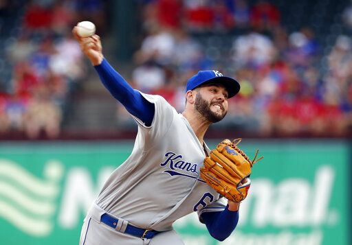 Kansas City Royals starting pitcher Jakob Junis throws to a Texas Rangers batter during the first inning of a baseball game in Arlington, Texas, Thursday, May 30, 2019.