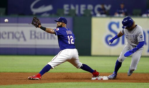 Texas Rangers second baseman Rougned Odor (12) reaches out for the throw as Kansas City Royals' Adalberto Mondesi reaches safely on an infield single by Alex Gordon during the sixth inning of a baseball game in Arlington, Texas, Thursday, May 30, 2019.