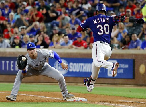 Kansas City Royals first baseman Ryan O'Hearn reaches out for the throw for the out against Texas Rangers' Nomar Mazara during the eighth inning of a baseball game in Arlington, Texas, Thursday, May 30, 2019.