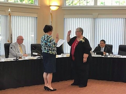 "Hanover Township Clerk Katy Dolan Baumer, left, swears in new trustee Alisa ""Lee"" Beattie at Thursday's meeting."