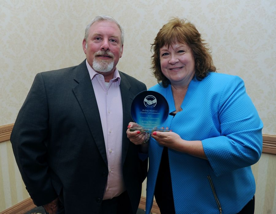 Kathy Jemilo and her boss Clay Ralston of Phillips Edison received the Community Enhancement award Thursday at the Rolling Meadows Chamber of Commerce Circle of Success recognition dinner.