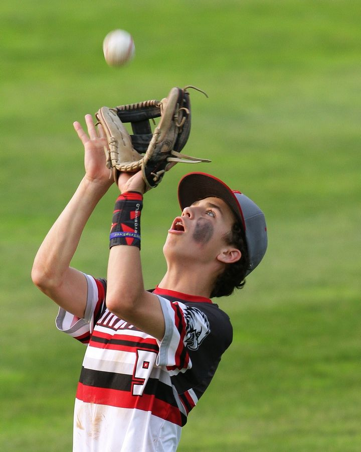 Aurora Christian's McCade Weber makes a catch in right field during his team's Class 2A state semifinal baseball game against Pleasant Plains. The Eagles advance to Saturday's IHSA third place contest after falling to the Cardinals, 6-3.