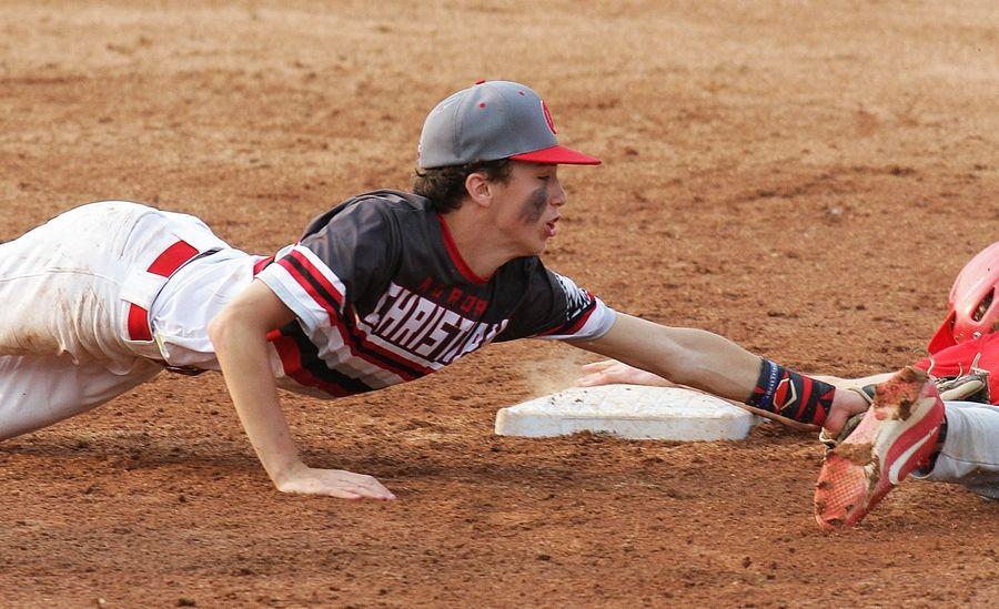 Aurora Christian's McCade Weber dives to make a tag at second base in their Class 2A state semifinal game against Pleasant Plains Friday in Peoria.