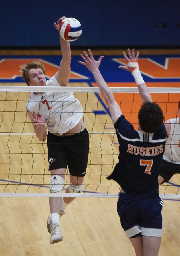 Barrington's Ben Ridgway leaps for a kill as Oak Park-River Forest's Kyle Rasmussen tries to block the ball at the net during the boys state volleyball semifinal at Hoffman Estates Friday.