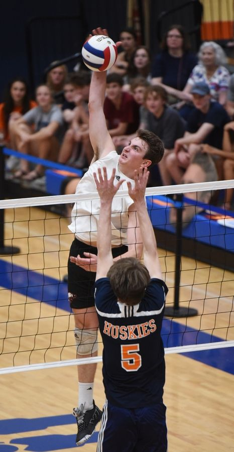 Barrington's Gabe Hartke leaps for a kill as Oak Park-River Forest's Quinton Kitzman defends during the boys state volleyball semifinal at Hoffman Estates Friday.